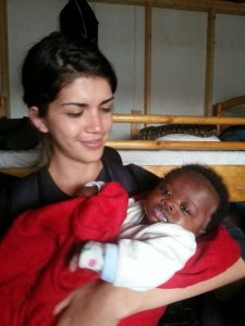With one of the infants at the Good Samaritan Home