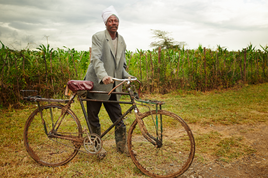 Title: Commute to Work Photographer: Christoph Siegert Location: Fiwagoh Mission. Gilgil, Nakuru, Kenya. 2016 Description: A laborer is about to go home after working in our Kitechild funded greenhouses at the Fiwagoh MIssion. This project has provided steady employment to members of the surrounding community as they work on the farm, and learn to cultivate their own smaller farms at home.